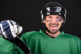 image of bruises  - Funny hockey player smiling bruise around the eye - JPG
