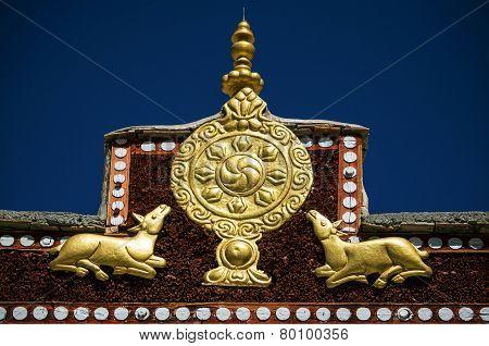Wheel of Dharma and golden deers