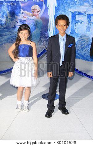 LOS ANGELES - NOV 19: Eva Bella, Tyree Brown at the premiere of Walt Disney Animation Studios' 'Frozen' at the El Capitan Theater on November 19, 2013 in Los Angeles, CA