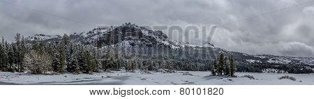 Panorama of snow clad mountain peak