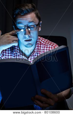 Man weeping with book