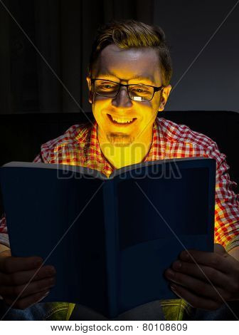 Young man reading comedy