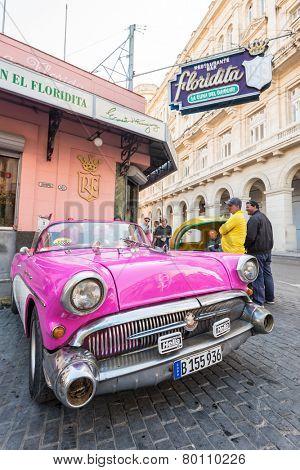HAVANA, CUBA - JANUARY 8, 2015 : Old american car next to the famous Floridita restaurant in Old Havana