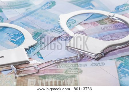 handcuffs and money isolated