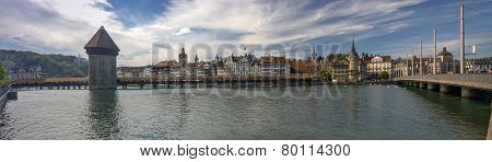 Lucerne, Switzerland - April 20, 2014: Panoramic View Of Famous Wooden Chapel Bridge With The Water