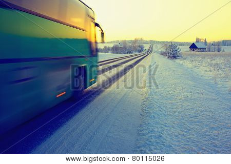 Bus Rides On Winter Road In The Snow