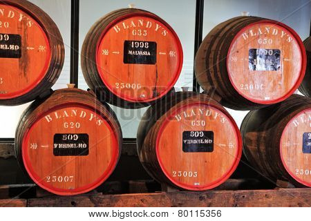 FUNCHAL, MADEIRA - OCTOBER 08, 2011: The museum - storage of expensive vintage wine Madera. Huge barrels are marked by data of wine