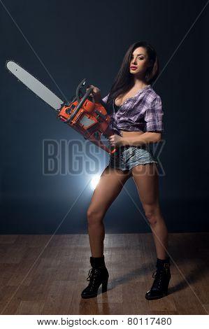 Studio shot of hot model advertises chainsaw