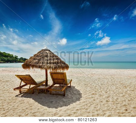 Two beach lounge chairs under tent on beach. Sihanoukville, Cambodia