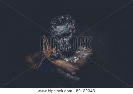 strong naked wild man with tribal paint