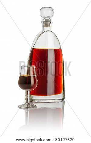 Carafe and snifter filled with brown liquid