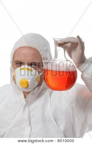 Scientist with glass flask with liquid