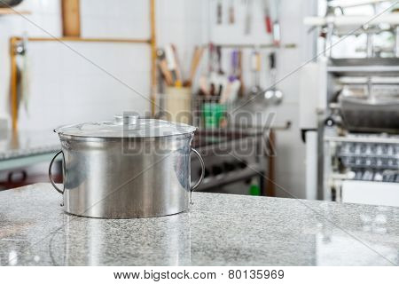 Closed pasta pot on marble countertop in commercial kitchen