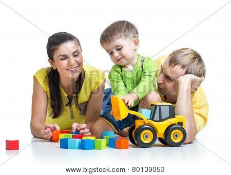 child boy with parents play building blocks