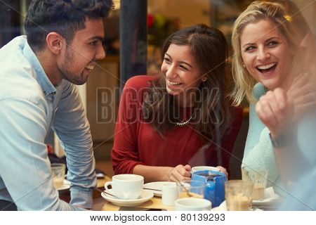 Group Of Friends In Caf�¢?? Relaxing Together