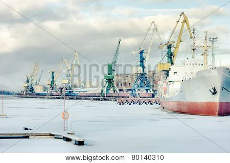 The Ship Is In Port Cranes On A Background Of Winter