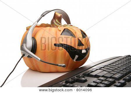 jack o lantern customer serivice with headset and keyboard