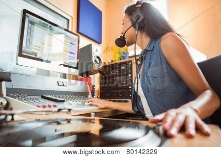 Portrait of an university student mixing audio in a studio of a radio