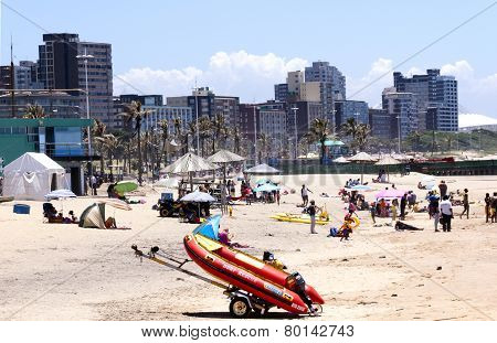 People And Dingy On Addington Beach In Durban