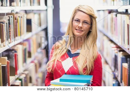 Mature student studying in the library at the university
