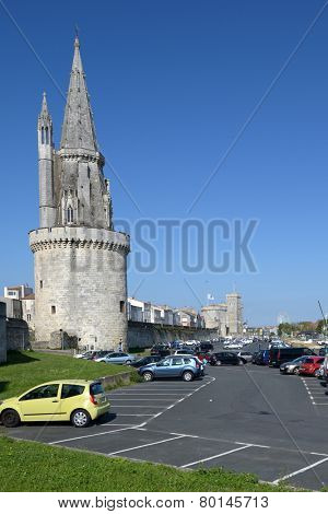 LA ROCHELLE, FRANCE - JUNE 24, 2013: Car parking under the Lantern Tower. Used as prison in XVII-XIX centuries, now the tower present the graffiti of prisoners