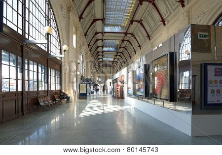LA ROCHELLE, FRANCE - JUNE 24, 2013: People in the train station of La Rochelle. The station building was built in 1922 and was renovated in the early 1990s for the arrival of the TGV Atlantique.