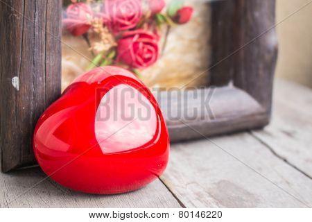 Heart And Frame On  Floor.