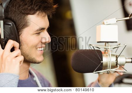 Portrait of an university student recording audio in a studio of a radio