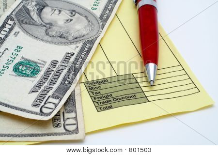 Blank invoice with pen and money (dollars)