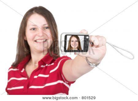 girl having fun with digital camera