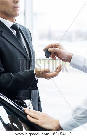 Giving A Key To A New Car Owner.