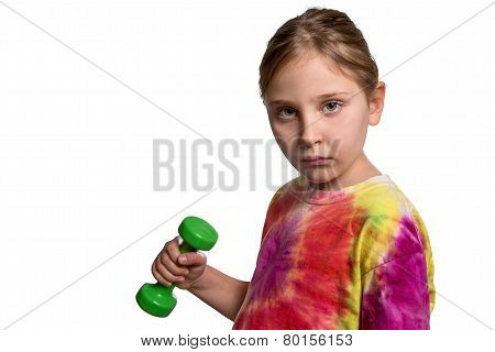 Serious Girl With Dumbbell Looking At Camera