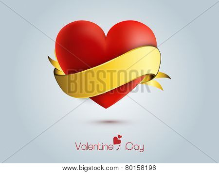 Happy Valentine's Day celebrations with red heart gift wrapped by golden ribbon on blue background.