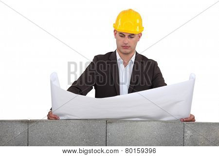 Man looking over a wall