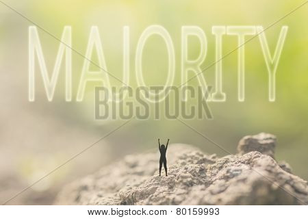 Concept of democracy with a person stand in the outdoor and looking up the text over the sky in nature background.