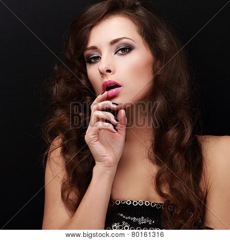 Sexy Woman With Erotic Look Holding Finger Near Mouth
