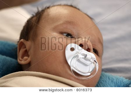 Baby sucking pacifier