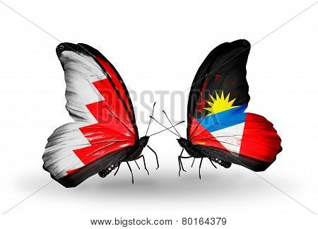 Two Butterflies With Flags On Wings As Symbol Of Relations Bahrain And Antigua And Barbuda