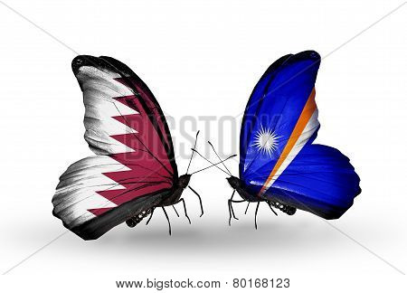 Two Butterflies With Flags On Wings As Symbol Of Relations Qatar And Marshall Islands