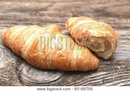 Croissants On The Wooden Table