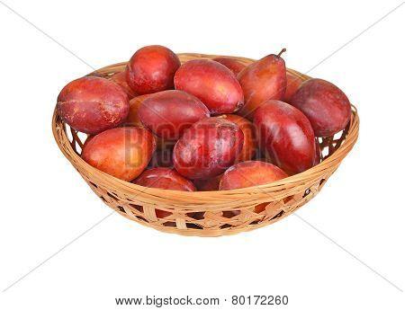 Plum in a wattled basket