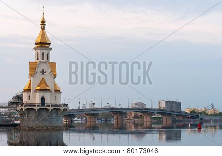 Capital of Ukraine - Kyiv. Church Saint Nicholas on the water, old embankment and Havanskyi Bridge
