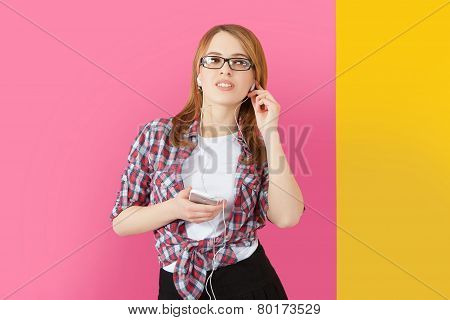 Woman With Headphones Listening To Music On Smartphone.