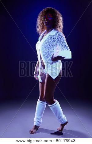 Image of creative girl dancing under neon light
