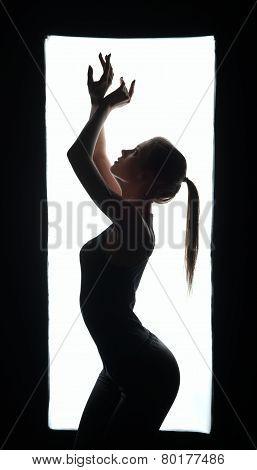 Silhouette of artistic dancer in frame