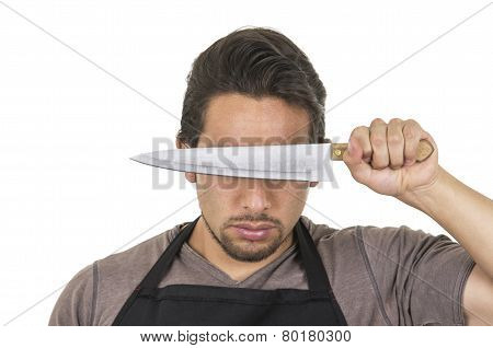 handsome young male chef wearing black apron