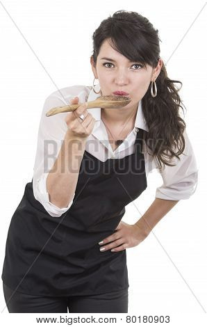 young beautiful female chef wearing black apron