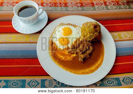 Bolon de verde with fried egg and meat stew ecuadorian food
