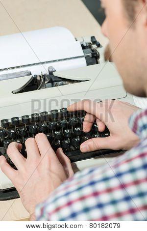 Working at the typewriter close up