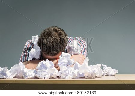 Author lying in the heap of paper